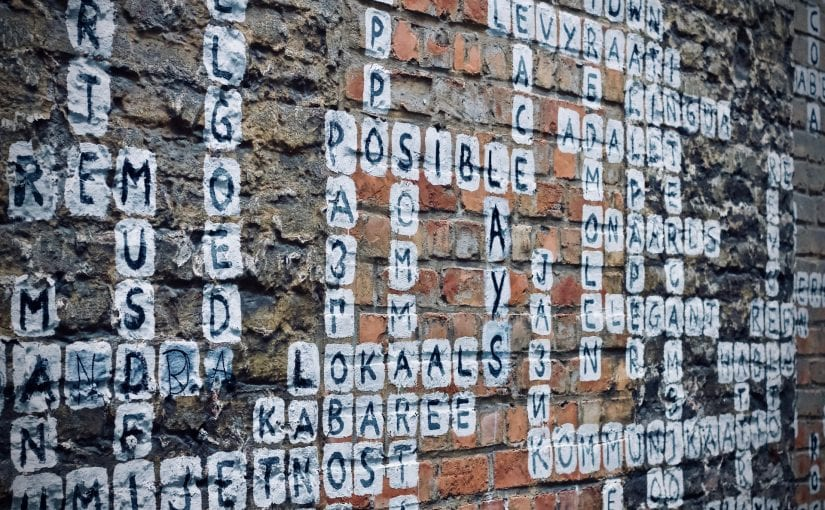 crossword puzzle painted on brick wall